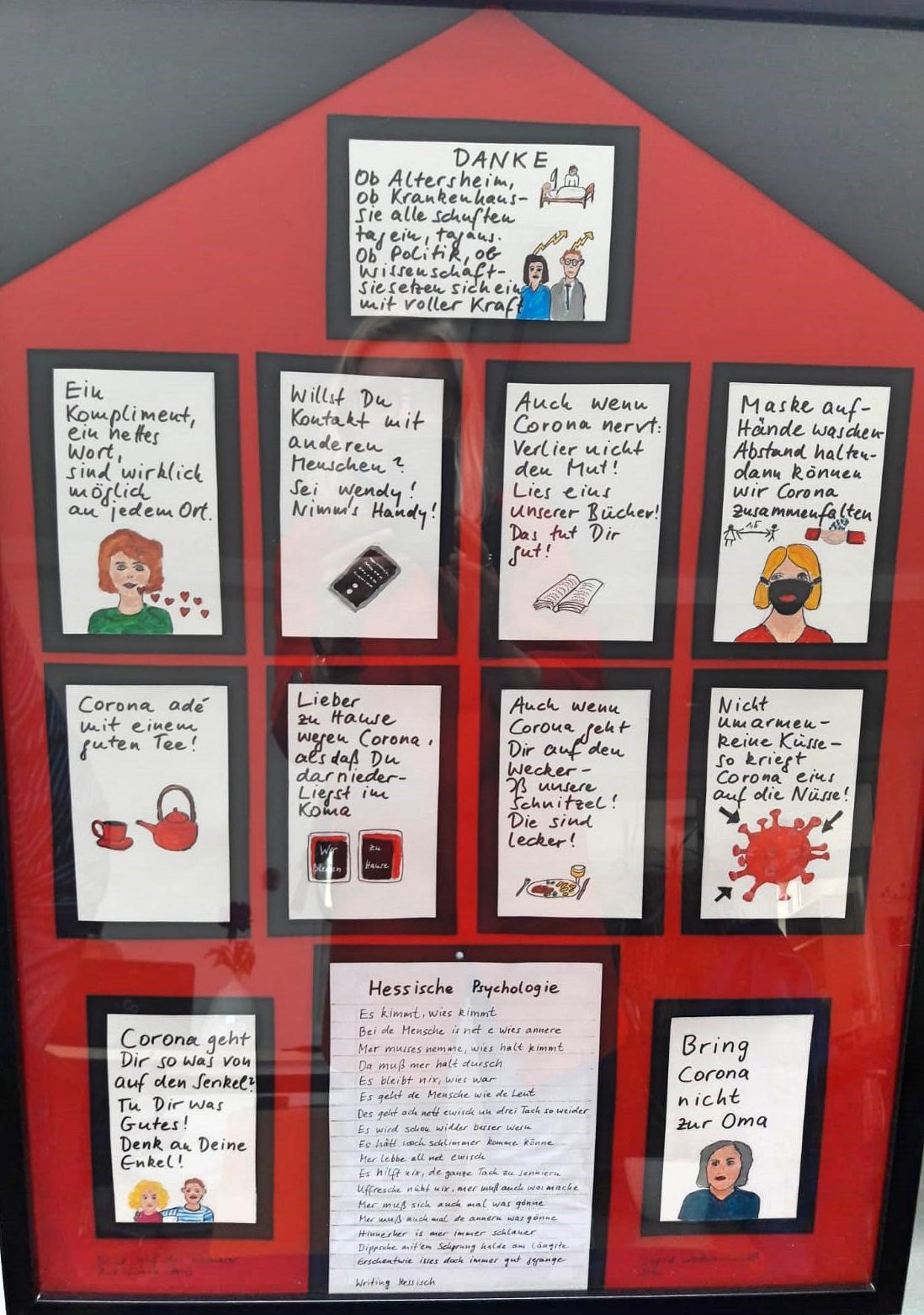"""12 kleinere Zettel mit schwarzen Rahmen sind auf einem großen roten Plakat, welches in Hausform geschnitten ist, angeordnet. Auf den Zetteln stehen Sätze mit kleinen Bildern darunter, z.B. """"Auch wenn Corona nervt, verlier nicht den Mut. Lies eins unser Bücher, das tut dir gut"""" mit einer Zeichnung eines Buches. Ganz unten ist eine """"Hessische Psychologie"""" aufgeschrieben"""