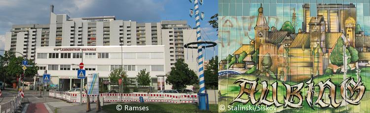 Zweiteilig: Links ein großes graues Wohngebäude mit einem kleinen Gebäude und Baustelle davor. Rechts ein Graffiti einer Stadt mit Schriftzug: Aubino.
